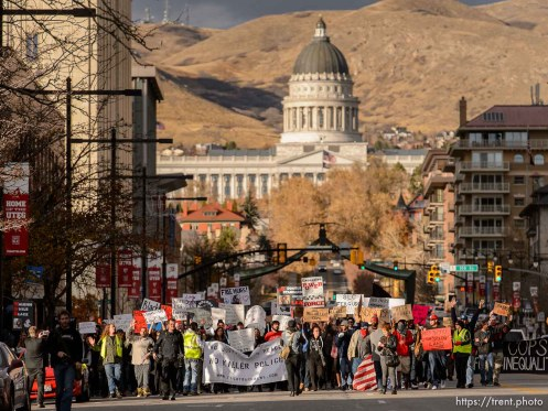 Trent Nelson | The Salt Lake Tribune Protesters march down State Street, halting traffic, as approximately 350 people turned out for a rally to protest police brutality in Salt Lake City, Saturday November 29, 2014.