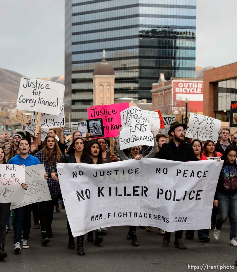 Trent Nelson | The Salt Lake Tribune Protesters march down 200 South, halting traffic, as approximately 350 people turned out for a rally to protest police brutality in Salt Lake City, Saturday November 29, 2014.