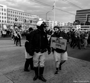 Trent Nelson | The Salt Lake Tribune Protesters march down State Street, with police providing traffic control, as approximately 350 people turned out for a rally to protest police brutality in Salt Lake City, Saturday November 29, 2014.