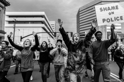 Trent Nelson | The Salt Lake Tribune Protesters march down the westbound lane of 400 South, blocking traffic, as approximately 350 people turned out for a rally to protest police brutality in Salt Lake City, Saturday November 29, 2014.