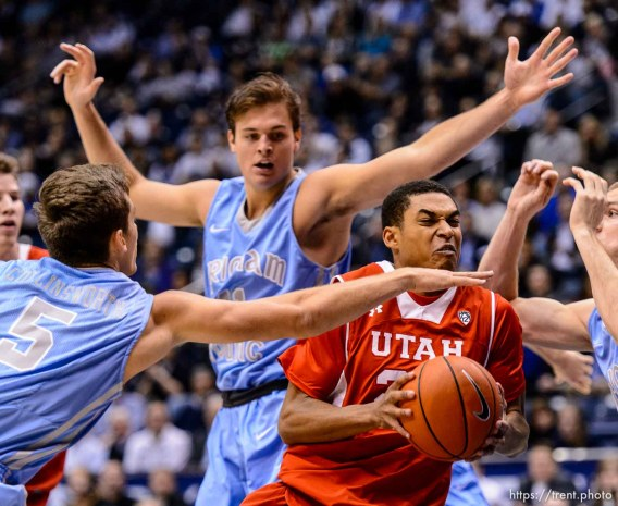 Trent Nelson | The Salt Lake Tribune Utah Utes guard Kenneth Ogbe (25) drives to the basket as BYU hosts Utah, college basketball at the Marriott Center in Provo, Wednesday December 10, 2014.