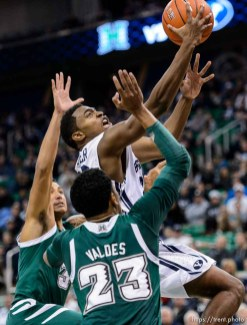Trent Nelson | The Salt Lake Tribune Brigham Young Cougars guard Anson Winder (20) shoots over Hawaii Warriors guard Aaron Valdes (23) as BYU faces Hawaii, college basketball at EnergySolutions Arena in Salt Lake City, Saturday December 6, 2014.