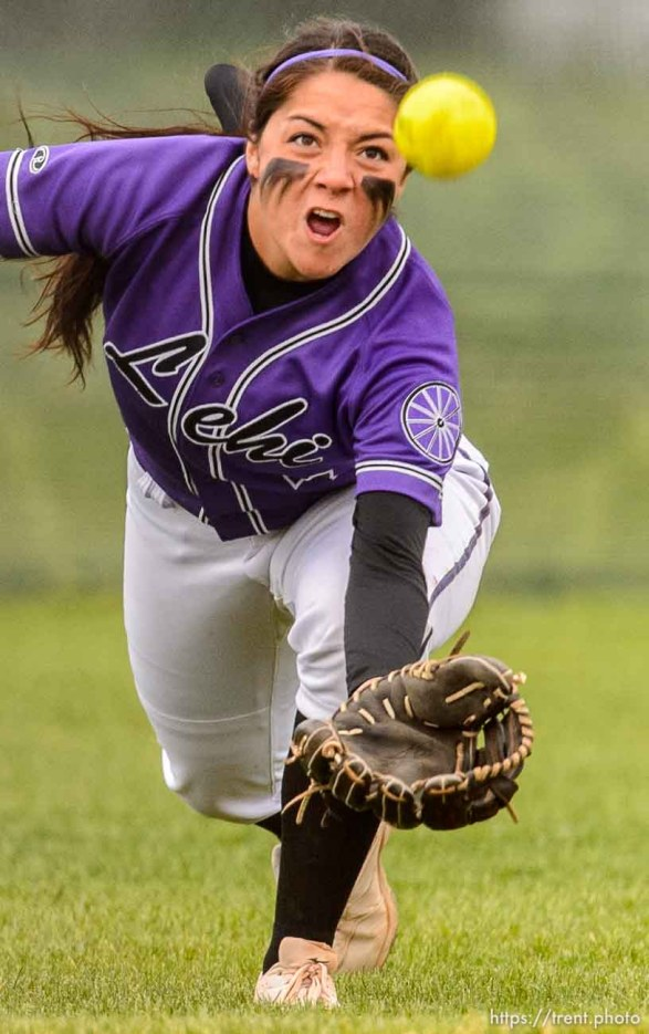 Trent Nelson | The Salt Lake Tribune Lehi's Taylor Tahbo dives for a ball during a 5A softball tournament second-round game between defending champion Lehi and No. 1 seed Taylorsville, Thursday May 14, 2015.