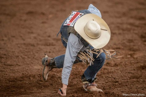 Trent Nelson | The Salt Lake Tribune Nathan Urie gets up after competing in Saddle Bronc at the Utah High School Rodeo Association state championships in Heber, Saturday June 6, 2015.
