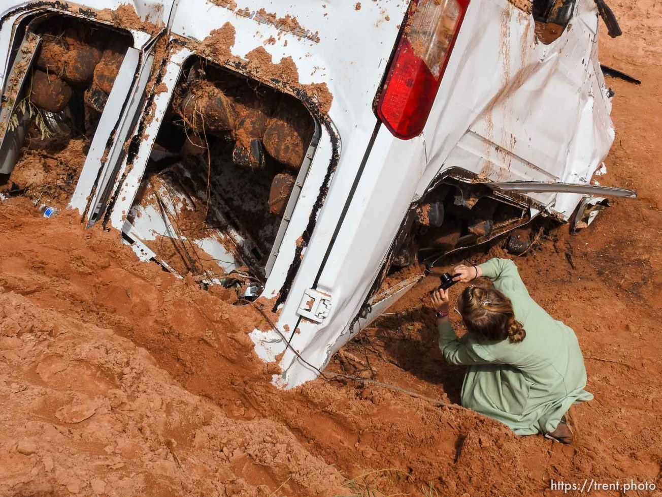 Trent Nelson | The Salt Lake Tribune People take in the scene in a Hildale wash where a flash flood killed nine people (with four still missing) Tuesday September 15, 2015., the day after an SUV and a van were washed off a road during a flash flood in this polygamous Utah-Arizona border community.