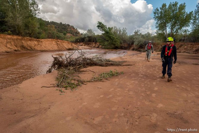 Trent Nelson | The Salt Lake Tribune Members of the Utah National Guard and Task Force One search the Short Creek Wash in Hildale, Wednesday September 16, 2015. The Utah National Guard and law enforcement on Wednesday resumed searching for the last known victim of a flash flood that tore through this polygamous border town home to followers of Warren Jeffs, leaving 13 dead and three injured, all of them women and children.