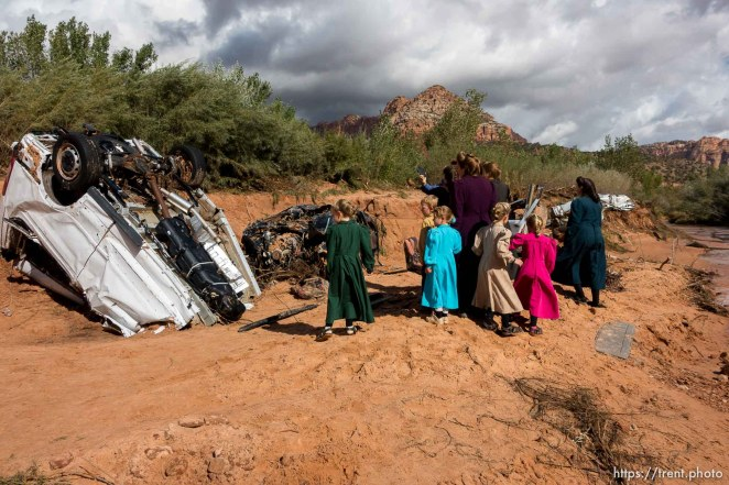 Trent Nelson | The Salt Lake Tribune A group of FLDS women gather at the scene of the flash flood tragedy in Short Creek Wash in Hildale, Wednesday September 16, 2015. The Utah National Guard and law enforcement on Wednesday resumed searching for the last known victim of a flash flood that tore through this polygamous border town home to followers of Warren Jeffs, leaving 13 dead and three injured, all of them women and children.