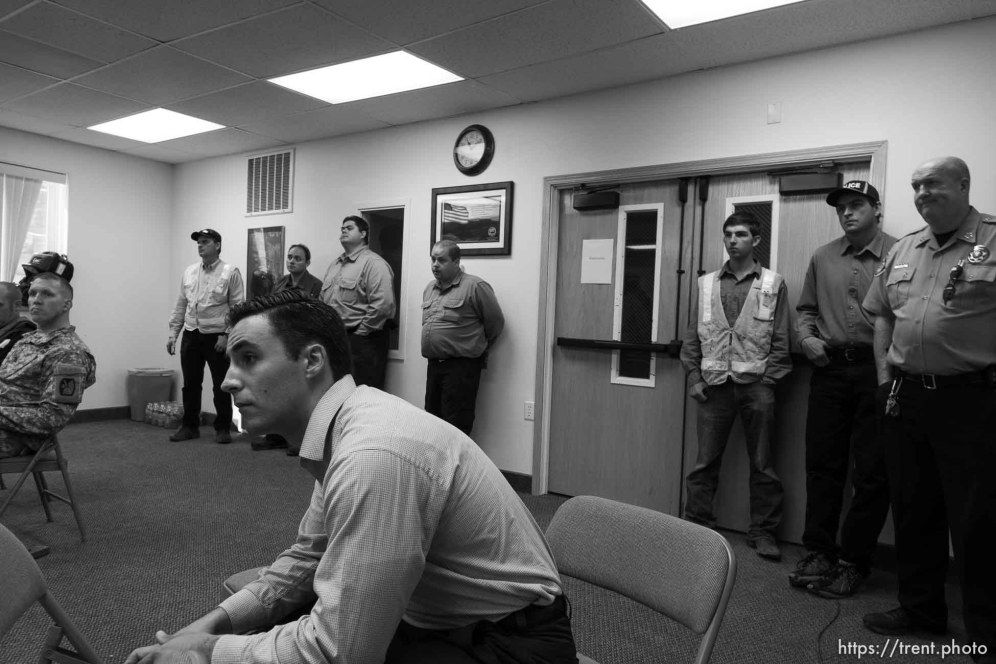 Trent Nelson | The Salt Lake Tribune FLDS looking on as Hildale Mayor Phillip Barlow speaks at a press conference regarding the continued search after a flash flood. Colorado City, Wednesday September 16, 2015. first four from left: david darger, sheldon black, marcus jeffs, curtis cook - marshal. at far right is Washington County Sheriff Cory Pulsipher and at his left is jerry darger chief of police (blk cap).