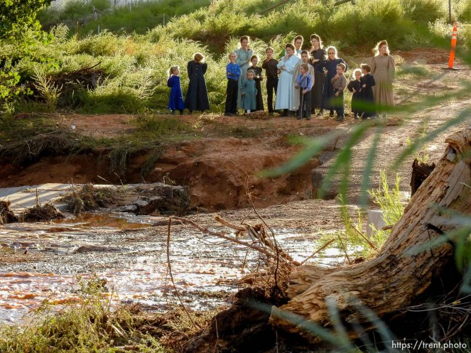 Trent Nelson | The Salt Lake Tribune People gather to look at the Short Creek Wash in Colorado City, Arizona, Wednesday September 16, 2015. The Utah National Guard and law enforcement on Wednesday resumed searching for the last known victim of a flash flood that tore through this polygamous border town home to followers of Warren Jeffs, leaving 13 dead and three injured, all of them women and children.