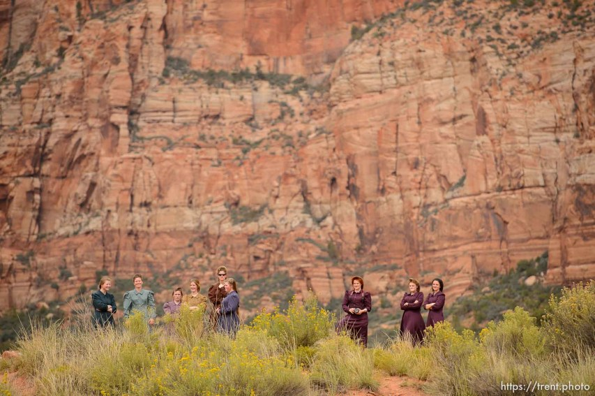 Trent Nelson | The Salt Lake Tribune Women arrive at a memorial for the 13 (and 1 still missing) victims of a September 14th flash flood. The memorial was held in Maxwell Park in Hildale, Saturday September 26, 2015.