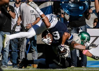 Trent Nelson | The Salt Lake Tribune Wagner Seahawks linebacker Nick Menocal (17) brings down Brigham Young Cougars wide receiver Trey Dye (6) as BYU hosts Wagner, NCAA football at LaVell Edwards Stadium in Provo, Saturday October 24, 2015.
