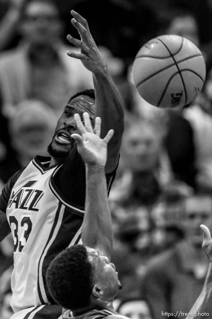 Trent Nelson | The Salt Lake Tribune Utah Jazz forward Trevor Booker (33) reaches for a loose ball as the Utah Jazz host the Toronto Raptors, NBA basketball at Vivint Smart Home Arena in Salt Lake City, Wednesday November 18, 2015.