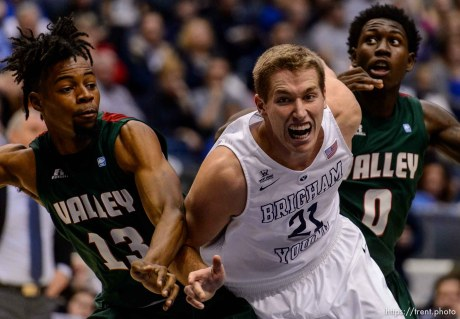 Trent Nelson | The Salt Lake Tribune Mississippi Valley State Delta Devils forward Jabari Alex (13), Brigham Young Cougars forward Kyle Davis (21), and Mississippi Valley State Delta Devils forward Vacha Vaughn (0) look for the rebound as BYU hosts Mississippi Valley State, NCAA basketball at the Marriott Center in Provo, Wednesday November 25, 2015.