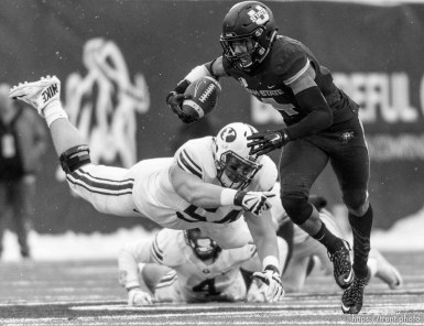 Trent Nelson | The Salt Lake Tribune Brigham Young Cougars offensive lineman Parker Dawe (54) dives after Utah State Aggies wide receiver Hunter Sharp (4) as Utah State hosts BYU, NCAA football in Logan, Saturday November 28, 2015.