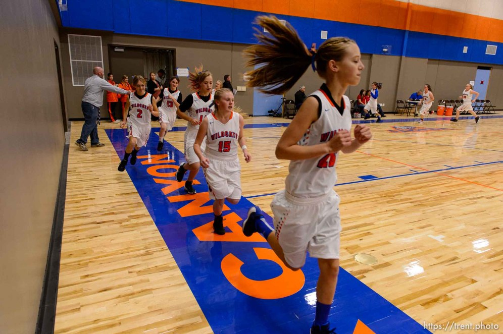 Trent Nelson | The Salt Lake Tribune Players on the court at Water Canyon School in Hildale as the school's girls' team warms up to play the first high school basketball game in a gym that used to be the FLDS bishop's storehouse, Wednesday December 2, 2015.
