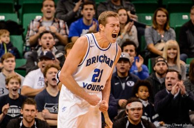 Trent Nelson | The Salt Lake Tribune BYU's Kyle Davis lets out a cougar roar as BYU faces Weber State, NCAA basketball at Vivant Smart Home Arena in Salt Lake City, Saturday December 5, 2015.