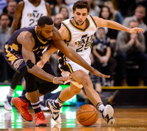 Trent Nelson | The Salt Lake Tribune New Orleans Pelicans guard Tyreke Evans (1) and Utah Jazz guard Raul Neto (25) chase down a loose ball as the Utah Jazz host the New Orleans Pelicans, NBA basketball in Salt Lake City, Wednesday December 16, 2015.