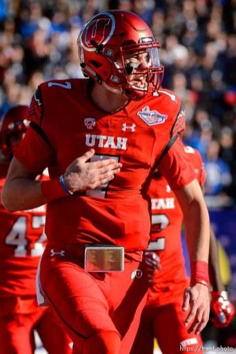 Trent Nelson   The Salt Lake Tribune Utah Utes quarterback Travis Wilson (7) celebrates a touchdown as Utah faces BYU in the Royal Purple Las Vegas Bowl, NCAA football at Sam Boyd Stadium in Las Vegas, Saturday December 19, 2015.