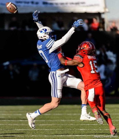Trent Nelson | The Salt Lake Tribune Brigham Young Cougars wide receiver Mitch Mathews (10) can't quite pull in the pass, with Utah Utes defensive back Dominique Hatfield (15) defending, as Utah faces BYU in the Royal Purple Las Vegas Bowl, NCAA football at Sam Boyd Stadium in Las Vegas, Saturday December 19, 2015.