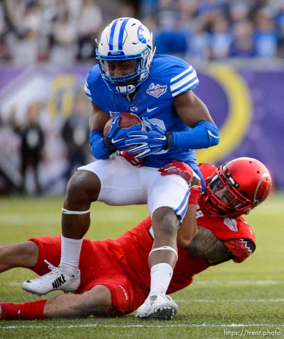 Trent Nelson | The Salt Lake Tribune Utah Utes defensive back Jason Thompson (3) pulls down Brigham Young Cougars defensive back Michael Shelton (18) in the third quarter as Utah faces BYU in the Royal Purple Las Vegas Bowl, NCAA football at Sam Boyd Stadium in Las Vegas, Saturday December 19, 2015.