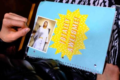 Trent Nelson | The Salt Lake Tribune A woman's notebook and a depiction of Jesus Christ, during the morning session of the 187th Annual General Conference at the Conference Center in Salt Lake City, Sunday April 2, 2017.