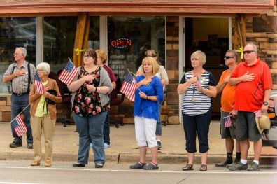 (Trent Nelson | The Salt Lake Tribune) Crowds line Main Street in Monticello to honor the motorcade of fallen soldier Aaron Butler, who was killed last week in Afghanistan, , Thursday August 24, 2017.