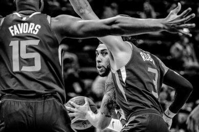 Chicago Bulls forward Denzel Valentine (45) is defended by Utah Jazz forward Derrick Favors (15) and Utah Jazz guard Ricky Rubio (3) as the Utah Jazz host the Chicago Bulls, NBA basketball in Salt Lake City Wednesday November 22, 2017.