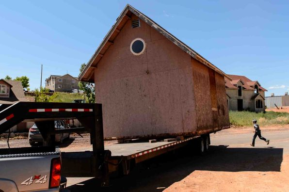 Trent Nelson | The Salt Lake Tribune An FLDS boy runs as a shed is removed from a Colorado City, Ariz., property posted with a second eviction notice from the UEP Trust, Monday May 1, 2017.