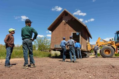 Trent Nelson | The Salt Lake Tribune A crew of FLDS boys assist a man moving a shed off of Colorado City, AZ, property posted with a second eviction notice from the UEP Trust, Monday May 1, 2017.