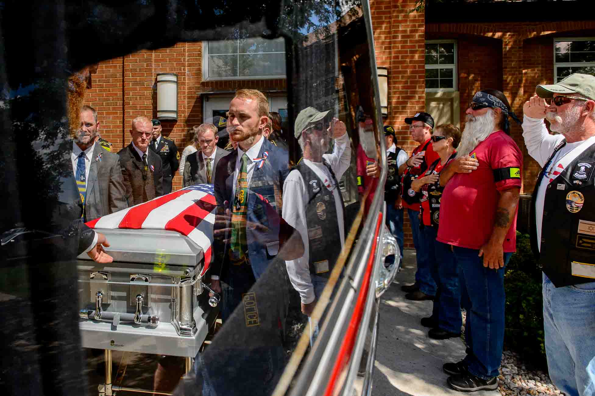 (Trent Nelson | The Salt Lake Tribune) Pallbearers at the funeral for fallen soldier Aaron Butler, in Monticello Saturday August 26, 2017. At right are members of the Patriot Guard Riders.