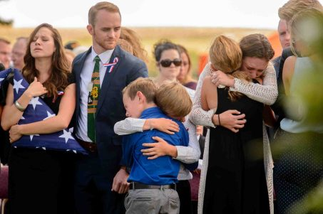 (Trent Nelson | The Salt Lake Tribune) Family members grieve at the graveside service for fallen soldier Aaron Butler, in Monticello Saturday August 26, 2017. At left is Alexandria Seagroves, Butler's fiancé.