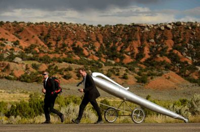 (Trent Nelson | The Salt Lake Tribune) German artists Wolfgang Aichner and Thomas Huber on the first day of their art project, Linear, about ten miles northwest of Vernal Wednesday September 13, 2017. The duo are launching a four-week long performance art project in which they are filming themselves dragging an oversized giant silver pen through a 250-mile rectangular through the deserts of Utah, Wyoming and Colorado.