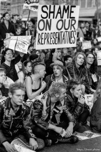 """Punks with """"shame on our representatives"""" sign at an anti-war protest the night the air campaign of the Gulf War began. Market Street, San Francisco, California, January 16, 1991."""