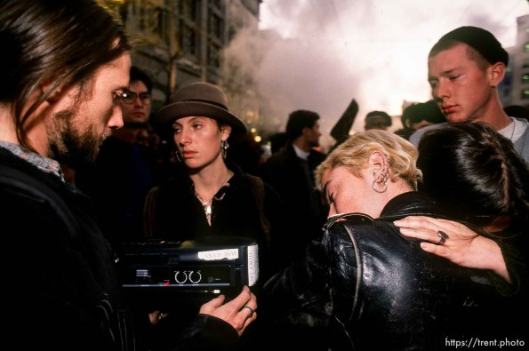 People embrace in sorrow while listening to radio reports about the bombing of Baghdad, which had just begun, on Market Street at Gulf War protest.