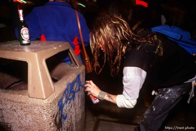 Spray painting a garbage can during Anti war Gulf War protests.