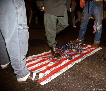 Desecrating the U.S. flage at Anti war Gulf War protests.