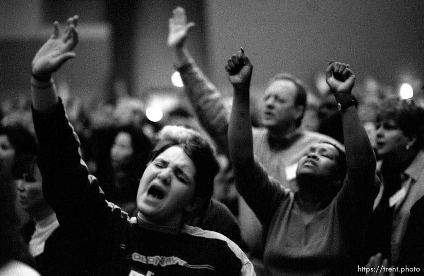 Darby Nelson praises God at a Penecostal meeting Thursday night at Judge High School.