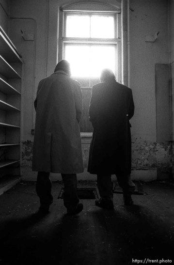 Ted Hansen and Alex Van Valin urinating in the old Academy Building.