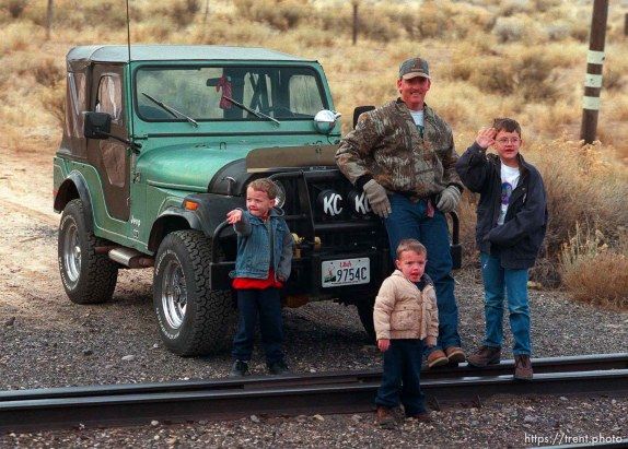 Father, jeep and sons waves to the Governor's Centennial Train