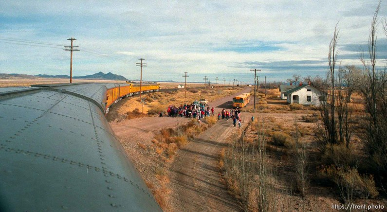 People wave to the the Governor's Centennial Train in the tiny town of Lund