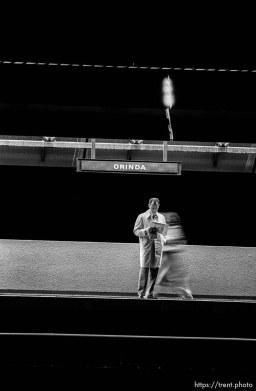 Commuters waiting for BART train before sunrise.