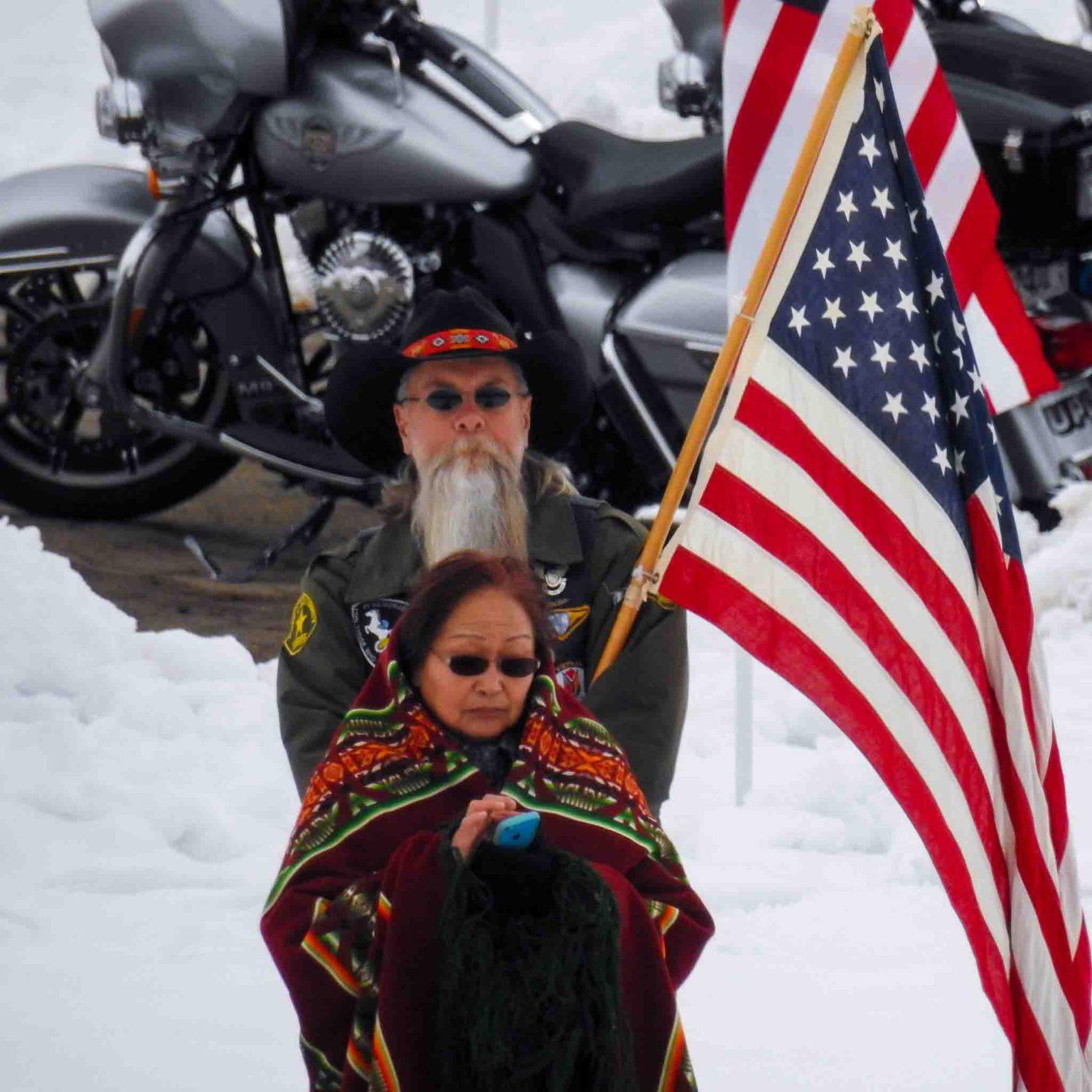 Trent Nelson | The Salt Lake Tribune Onlookers at the graveside service for Officer Douglas Scott Barney, at the Orem Cemetery, Monday January 25, 2016.