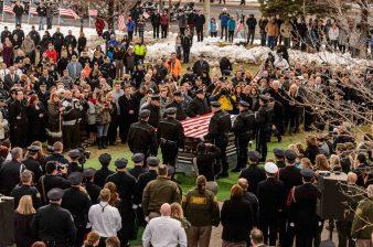 Trent Nelson | The Salt Lake Tribune Officers fold a flag at the graveside service for Officer Douglas Scott Barney, at the Orem Cemetery, Monday January 25, 2016.
