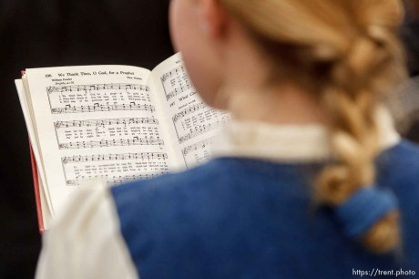 """Trent Nelson   The Salt Lake Tribune A young girl sings the hymn, """"We Thank Thee, Oh God, for a Prophet"""" during a church service of ex-FLDS members Sunday, February 17, 2013 in Hildale."""
