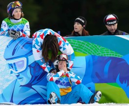 Nelly Moenne Loccoz, France, is comforted after placing 7th in the Ladies' Snowboard Cross, at the XXI Olympic Winter Games in Vancouver, Tuesday, February 16, 2010.