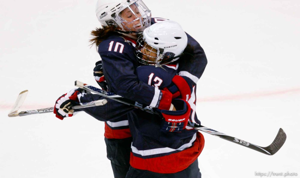 USA's Meghan Duggan (left) and USA's Julie Chu celebrate Duggan's first period goal that put USA up 2-0. USA vs. Sweden, women's hockey, at the XXI Olympic Winter Games in Vancouver, Monday, February 22, 2010.