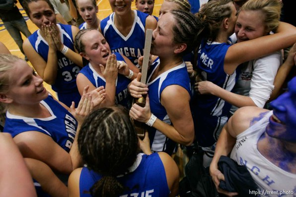 Bingham's Lexe Jacobs kisses the state championship trophy. Taylorsville - Bingham wins the state championship. Bingham vs. Skyline High School, 5A Girls State Basketball Championship game at Salt Lake Community College.