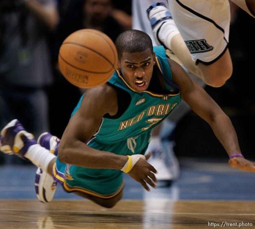 Chris Paul dives for loose ball. Utah Jazz vs. New Orleans/Oklahoma City Hornets NBA Basketball.