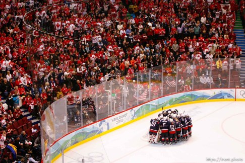 Trent Nelson | The Salt Lake Tribune Team USA huddles before a Canadian crowd prior to the game. USA vs. Canada, gold medal game, women's Ice Hockey at the Canada Hockey Place, Vancouver, XXI Olympic Winter Games, Thursday, February 25, 2010.