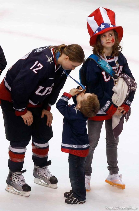 Trent Nelson | The Salt Lake Tribune USA's Jenny Potter leans down for her son Cullen to kiss her silver medal. Potter's daughter Madison at right. Canada defeats Team USA in the gold medal game, women's Ice Hockey at the Canada Hockey Place, Vancouver, XXI Olympic Winter Games, Thursday, February 25, 2010.
